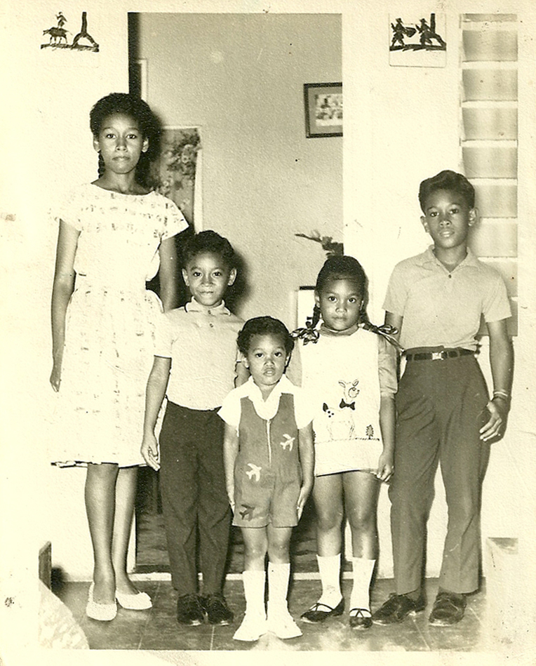 Anthony (far right) with his cousins (left to right) Joan, Michael, Roger and Georgia Moo-Young. Outside a family member's house, Port Antonio, Jamaica. Circa 1966.